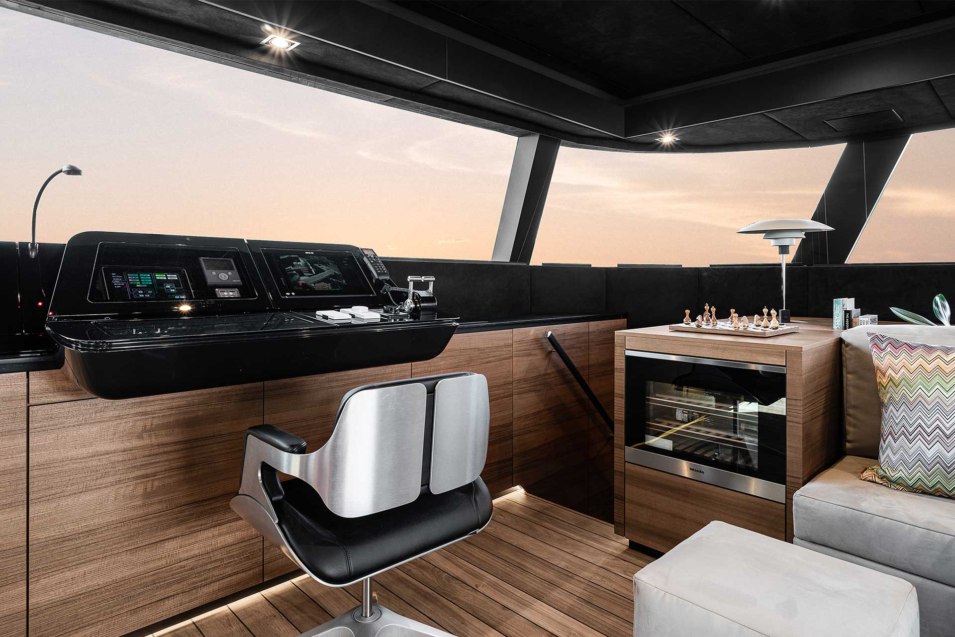 Helm station located in the saloon of the electric sailing catamaran Sunreef 60 Eco.