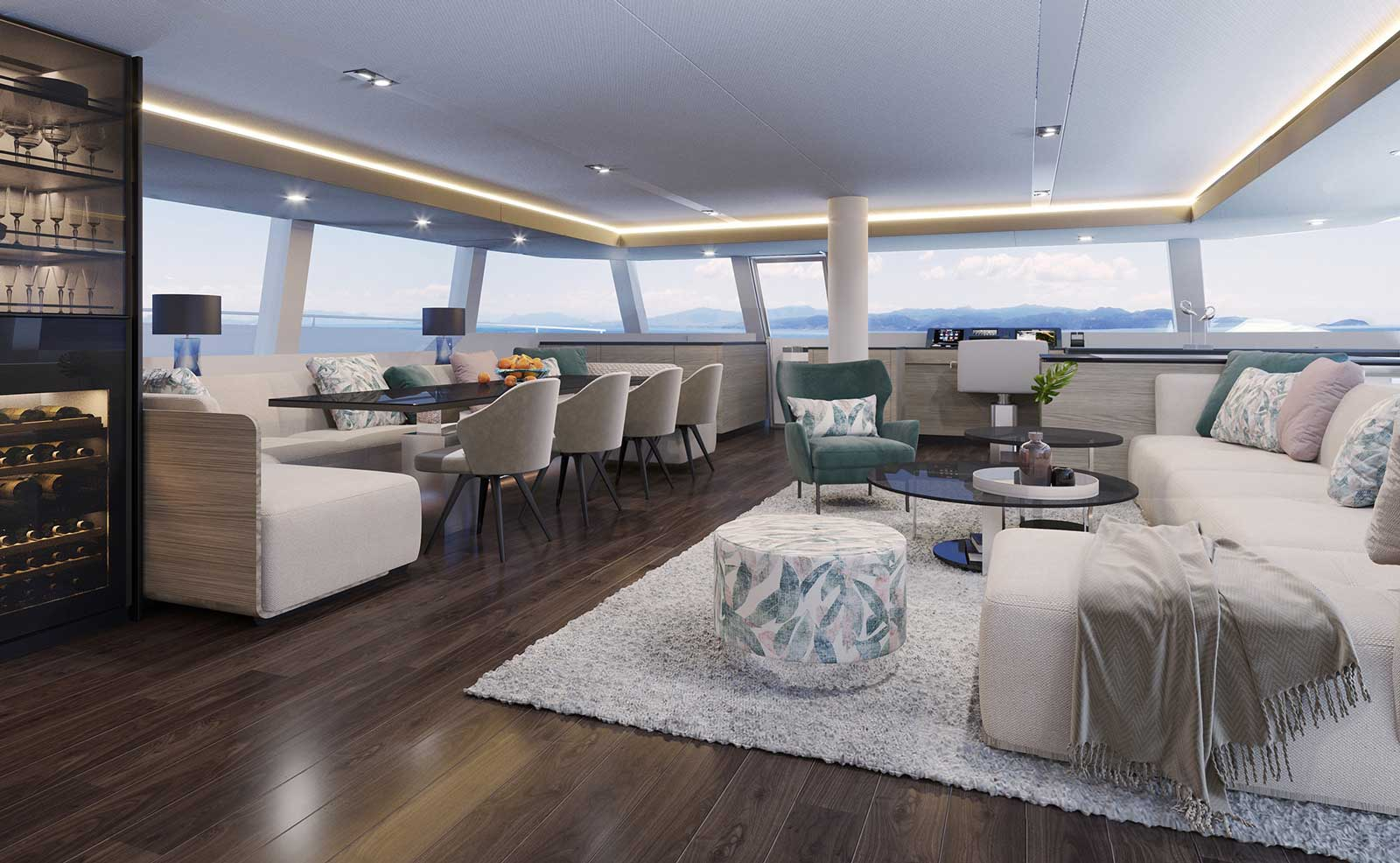 Main saloon of the Sunreef 70 Eco with two zones, dining and lounging areas, all in bright upholstery with tropical green and rose elements.