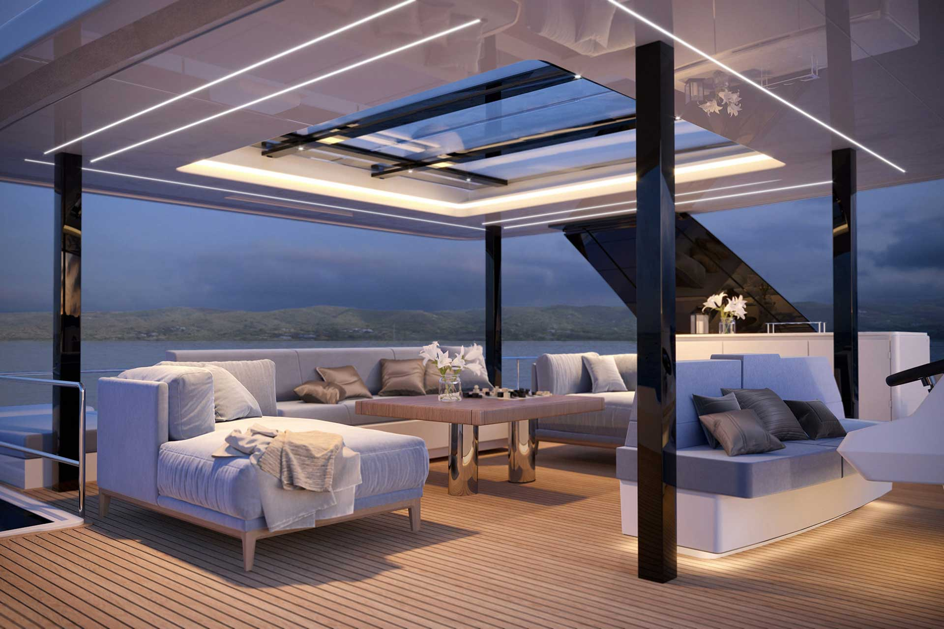 60 Sunreef Power Eco flybridge featuring spacious lounging area with three light grey sofas and a coffee table.