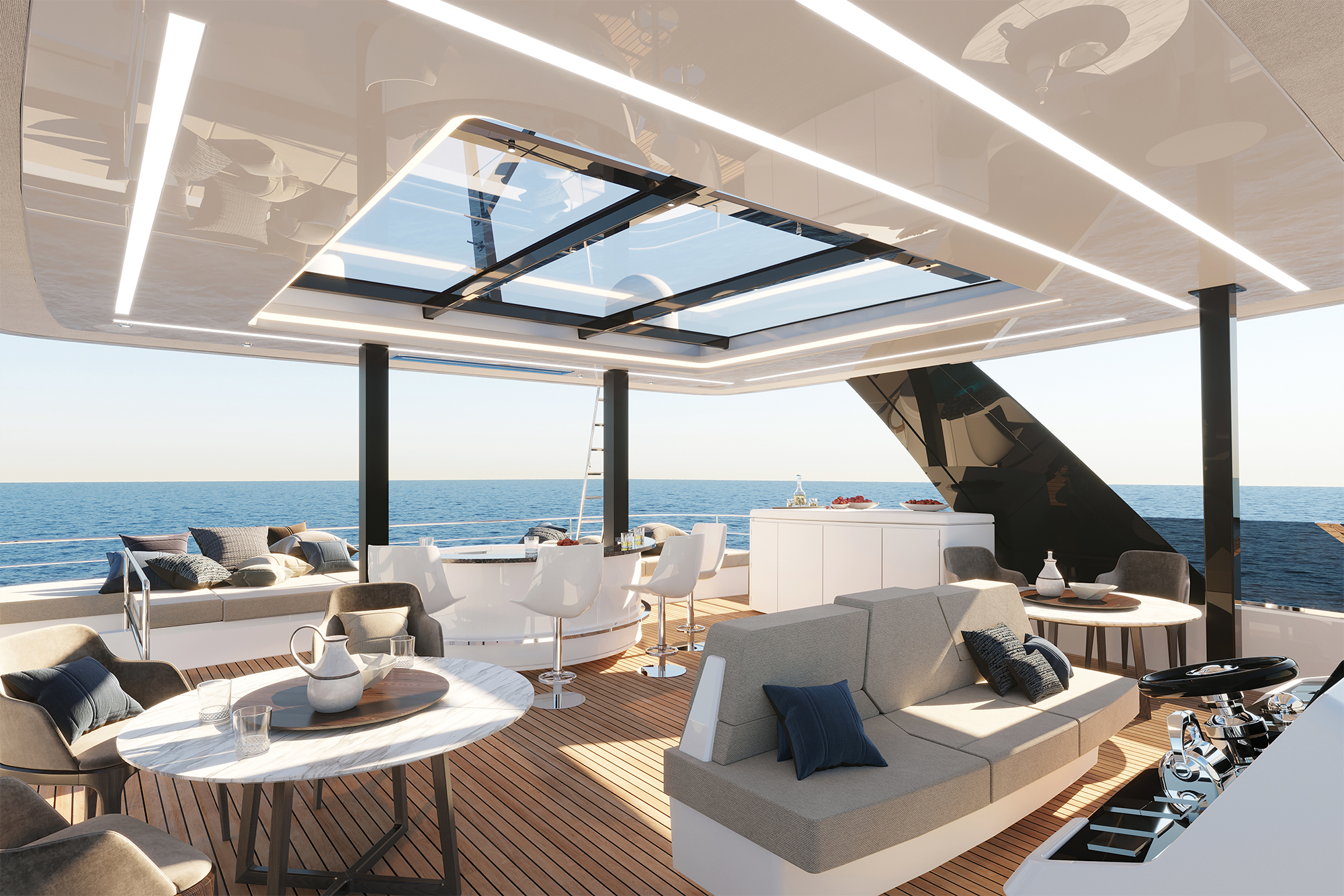 Flybridge of the electric power catamaran 70 Sunreef Power Eco with a helm station in the middle and a bar and a spa pool.
